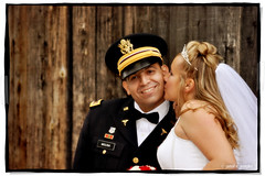 On the Cheek (Proleshi) Tags: wood wedding light woman white man tiara smile smiling wall hair outside army bride wooden nikon kiss married veil cheek dress princess outdoor military bowtie marriage blond blonde flowing bouquet weddingdress bridal proleshi