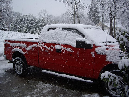 The little red truck covered in snow