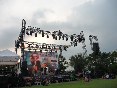 Lighting rig, loreto fest with acrobatic worker