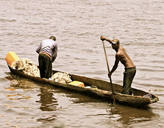 Fishers on the Congo River (andreea_gerendy) Tags: africa water waves mud floating fisher congo woodenboat pirogue equator kinshasa brazzaville congolese congoriver canoneos50d andreeagerendy