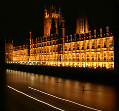 Houses of Parliament (DavidStGr) Tags: longexposure light orange london yellow thames night river lights boat housesofparliament 2009