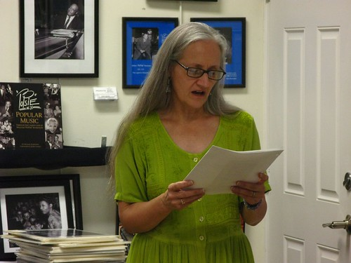 Barbara Brenner recites some of her favorite poetry to the guests of the League.