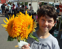 With sunflowers at the farmers' market