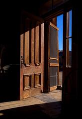 Gold Rush (Paul Gaither Photography) Tags: california travel abandoned ruins doorway highdesert abandonedhouse ghosttown bodie desolate deserted hdr doorways desolation goldrush hdri miningtown boomtown highplains bodieghosttown goldmining photomatix monocounty bodiecalifornia d80 nikond80 flickraward nikonflickraward