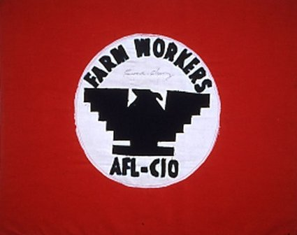 the iconic UFW flag. A black winged bird in a white circle on a red background