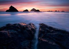 Bandon Rock (Sheldon Nalos) Tags: sunset sea oregon landscape coast rocks waves crack pacificocean bandon canon1dsmarkiii sheldonnalos