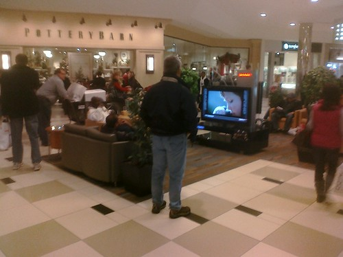 Ptw 12 Oaks mall, Guy friendly Big Wcreen Tvs in walkway with footb all