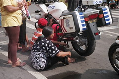 to protect and serve (elyant) Tags: people analog streetphotography surabaya canonp fujisuperia200 jupiter850mmf2