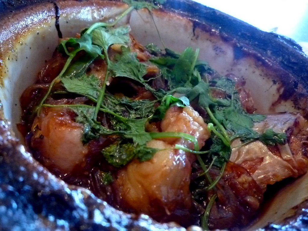 Caramelized catfish claypot with cilantro, ginger and Thai chillies
