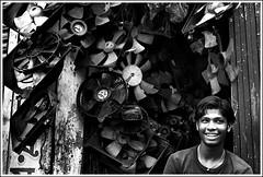 In his world of machines [..Dhaka, Bangladesh..] (Catch the dream) Tags: boy broken smile metal shop death pattern metallic bongo machine happiness grease rotation oily vendor blade fans dhaka machines scrap bengal bangladesh greasy exhaust rotor bangladeshi exhaustfans dholaikhal gettyimagesbangladeshq2