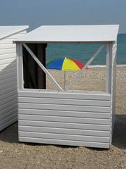 Beach hut and umbrella (Katie-Rose) Tags: uk blue red sea sky sun white green yellow umbrella sand dorset beachhut weymouth katierose canonpowershota700 fbdg