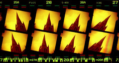 eight crooked spires and sprocket holes (pho-Tony) Tags: red orange color colour film church st parish bar analog 35mm spiral 3d code all fuji superia saints 8 ishootfilm holes iso spire stereo cast 400 marys barcode analogue 135 bent hue twisted eight chesterfield crooked viewmaster stmarys perforations sprocket c41 sprocketholes sawyers okto filmisnotdead redscale octych octuplet 8up  stmarysandallsaintsparishchurch