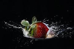 Strawberry and cream (Wim van Bezouw) Tags: strawberry cream spoon pluto fruit splash highspeed plutotrigger flashphotography speedgun creamer