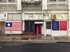 Do The Right Thing (misterbigidea) Tags: outdoor downtown city urban landscape cityscape street sidewalk redwhiteblue patriotic liberty painted doorway flag political democracy homeofthefree usa explore