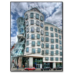 Prague Dancing Building (Mike G. K.) Tags: windows sky building glass architecture modern clouds geotagged weird prague praha praga explore cables wires czechrepublic hightech shape curved frontpage dri hdr hdri controversial dancingbuilding gingerandfred blueribbonwinner dancinghouse explored 3exp drunkhouse geo:lon=1441359 ančícídům geo:lat=50075815