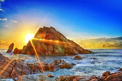 Australia (Kenny Teo (zoompict)) Tags: sunset seascape tourism rock canon lens wave australia tourist perth western flare rays 1855mm sugarloaf kenny 2009 magnificent photoimpact eos1000d zoompict standardkit 05wideangleadaptor