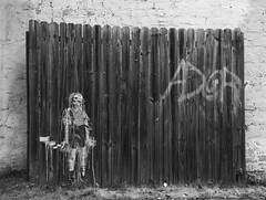 Child with toy hand grenade street art (Max Eremine) Tags: boy blackandwhite bw streetart fence toy graffiti war peace child hand olympus urbanart grenade eastatlanta eav pacifism evolt e500 eastatlantavillage dwcffurban