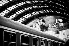 (Chrispz) Tags: bw milan train kiss milano commercial moschino lombardia centralstation blackdiamond stazionecentrale platinumheartaward lovemoschino