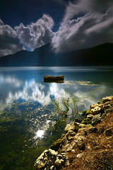 hard light (tropicaLiving - Jessy Eykendorp) Tags: longexposure light sky bali lake nature water clouds indonesia landscape rocks crater batur kintamani efs1022mm lakescape hardlight outdoorphotography canoneos50d tropicaliving hoyandx400