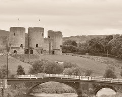Rhuddlan Castle (Etrusia UK) Tags: uk greatbritain bridge trees sky castle history castles cars water sepia wales clouds geotagged woods nikon ruins britishisles zoom unitedkingdom fort britain telephoto gb walls monuments fortress stonewalls 18200 brickwork pictureperfect vegatation d300 nikkorlens denbighshire cadw 18200mm nikonlens camerajpeg vrlens rhuddlancastle riverclwyd nikon18200mm nikkor18200mmvr nikkor18200mm nikon18200mmvr nikond300 cameraedit geo:lat=53290981 geo:lon=3472593