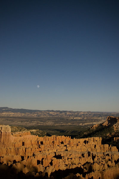 View from Bryce Point of the moon and hoodoos.  A popular tourist stop with more children wailing than safety railing.