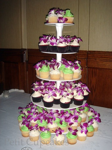 A cupcake tower filled with purple orchids for Candice Ben's Wedding