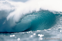 A beautiful glowing tube at Pipeline, on the north shore of Oahu, Hawaii. (Sean Davey Photography) Tags: pictures usa color green nature beautiful horizontal glitter danger photography hawaii big dangerous shiny energy solitude surf glow power oahu wave northshore dreamy curl pipeline crashing shimmer cascading greenenergy greenpower oceanwave seawave oceanswell northshoreoahu seandavey oceanpower seaswell photographyfineart finephotographyart curlingwave wavesenergy seawaveenergy oceanenergy oceanwavepictures seandaveyphotography