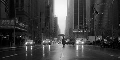 Rainy Avenue of the Americas (Airicsson) Tags: street new york city nyc light blackandwhite bw usa 6 white ny newyork man black reflection cars car rain america umbrella island lumix us noir crossing cross traffic walk manhattan cab taxi nb panas