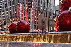 Giant Xmas Ornaments (NjCarGuy) Tags: christmas new york xmas city nyc red music tree water night radio giant hall ornaments topaz adjust