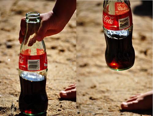 grabbing the bottle