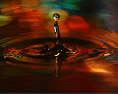 The Dancer, twirling gracefully (Mukumbura) Tags: red orange abstract macro reflection water dancer drop ripples graceful twirling watersculpture gracefully birthdayballoon waterdropmacro