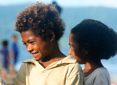 A boy with curly hair in Irian Jaya. (cookiesound) Tags: life trip travel summer vacation portrait holiday travelling smile face childhood closeup kids portraits canon hair children indonesia photography kid eyes reisen asia asien fotografie child urlaub canoneos20d papuanewguinea canoneos indonesian poeple reise facialexpression travelphotography traveldiary travelphotos travellingasia reisefotografie curles rajaampat faceexpression irianjaya facecloseup travelshots reisefotos indonesianchildren reisetagebuch portraitofpeople indonesiankids reisebericht travellifestyle cookiesound nisamaier ulrikemaier lifeinindonesia travellingindonesia