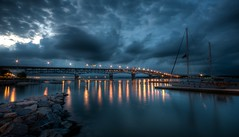 storm clouds over the coleman (djdphotos) Tags: york bridge storm water night clouds sailboat reflections river dark lights virginia boat dock nikon rocks wide dramatic sigma va gloucester yorktown 1020 hdr starburst d90 tonemapped colemanbridge