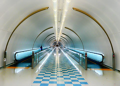 Narita (` Toshio ') Tags: blue people color japan asian person lights tokyo airport colorful asia long floor tube tubes perspective tunnel walkway checkered depth narita connecting movingwalkway toshio superaplus platinumheartaward