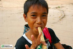 Asian boy playing flute (Asian Images) Tags: poverty travel boy portrait people musician music playing tourism boys smile smiling musicians kids portraits children asian kid workers asia cambodia asians cambodian cambodians child expression poor working smiles expressions flute buskers siem labour destination worker busker southeast peddler angkor minor ethnic performers performer eastern busking phnom flutes underage ethnicity penh bayon destinations minors peddlers
