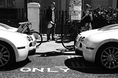 Bugatti Veyron 16.4: two of them (Jeroenolthof.nl) Tags: world uk england bw white black color london beautiful car modern volkswagen photography grey lights is blackwhite amazing nice movement jeroen nikon view shot britain united rear great d70s kingdom automotive harrods east emirates explore arab londres gb if 164 paparazzi rrr 407 lovely middle nikkor abu dhabi bugatti zwart wit londra exclusive supercar fastest vr 56 eb engeland londen veyron zw f35 emirati automotion molsheim 1685 olthof wwwjeroenolthofnl jeroenolthofnl jeroenolthof