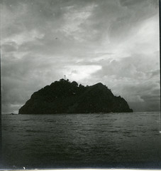 Small island with lighthouse off Manipa Island