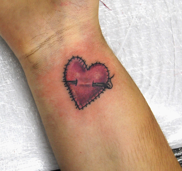 stiched heart tattoo on wrist. Tattooed by Johnny at;. The Tattoo Studio