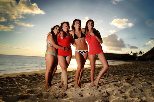 4 Italian Girls in bikini posing for photo in a Hawaii Beach