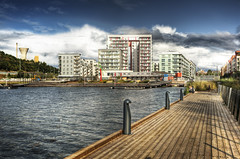 Hammarby Sjstad - Exaggerated HDR (Hannes R) Tags: city houses sky house building water skyline clouds buildings pier town apartments apartment sweden stockholm boardwalk hdr hammarby sickla hammarbysjstad sicklaudde 6exp sjstan
