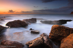 First Light (-yury-) Tags: ocean longexposure light sea sky sun beach water clouds sunrise canon rocks sydney australia bungan