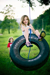 just a swingin (-Angela) Tags: summer childhood canon innocent tire swing tireswing swinging 2009 carefree