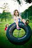 just a swingin (-Angela) Tags: summer childhood canon innocent tire swing tireswing swinging 2009 carefree