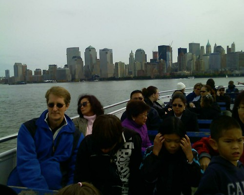on board the ferry to the statue of Liberty.