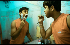 Day 021/365 | Good Morning! (cishore) Tags: red portrait india reflection self tooth beard bathroom mirror weekend saturday brushing boredom cleaning shaving photoaday multiple puma hyderabad clone day21 2009 cishore kishore hws october24 project365 nagarigari hyderabadweekendshoots kishorencom teamhws