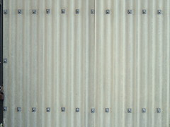 corrugated polyester wall with bolts (Mr Thinktank) Tags: wood flowers windows brick textur