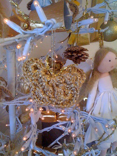 Beautiful Golden Butterfly twinkles in my tree.