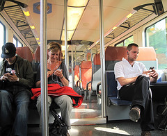 Modern Times (Harry -[ The Travel ]- Marmot) Tags: holland nederland netherlands dutch train passengers passagiers forenzen dailycommute communication modern times smart phone thumb work interior ns nederlandsespoorwegen sprinter earphones oordoppen koptelefoon oortjes commuters