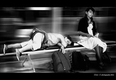 a traveler's dream (Chez C. - busy..) Tags: street motion travelling pen nap candid olympus wornout f3556 1442mm epl2