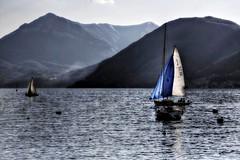 Perspecitves (Lookaloopy) Tags: italy lake como backlight canon lago eos boat barca natura vela lombardia controluce dervio 450d